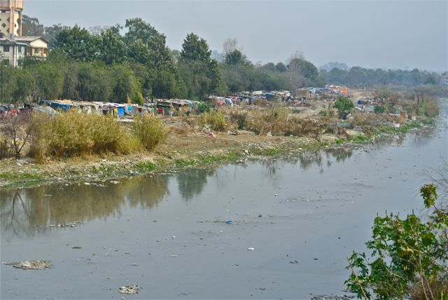 Squatters' shacks by the smelly river