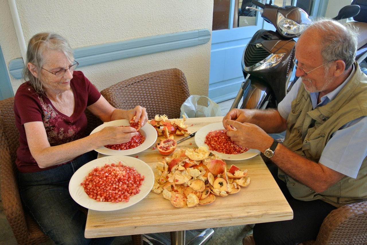 Judy and Dimitrios (my plate was the third one) preparing pomegranate seeds for juicing