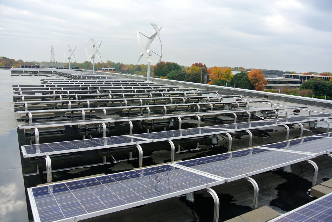 Andy Levin's rooftop energy project--Solar panel arrays with helical wind power generators