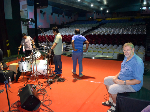 Christian waits patiently as the drums get set up in the Pune concert hall (3000 seats)