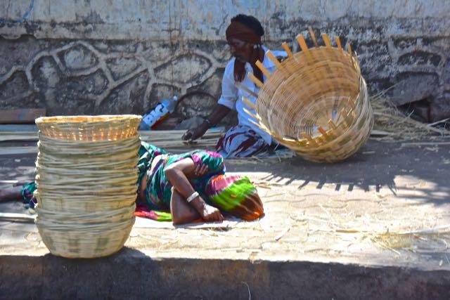 A street basket maker takes a nap