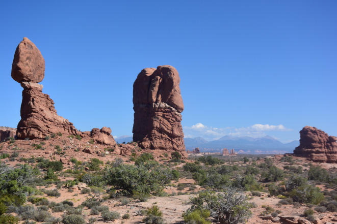 Balance Rock and Arches National Park panorama. Notice the people standing at the right side of Balance Rock.