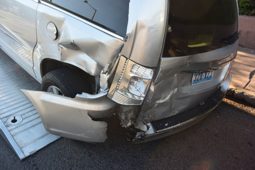 Our faithful Chrysler van, crunched by a drunk driver