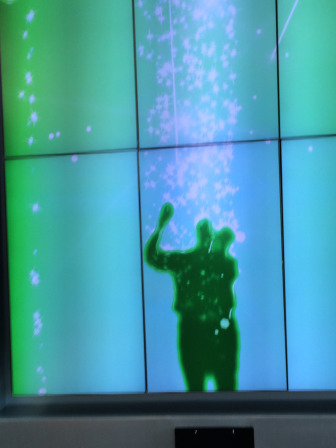 An infrared projector projects my image on the wall of the Children's Hospital atrium