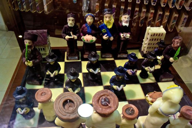 A chess set made of candles representing different Jewish figures